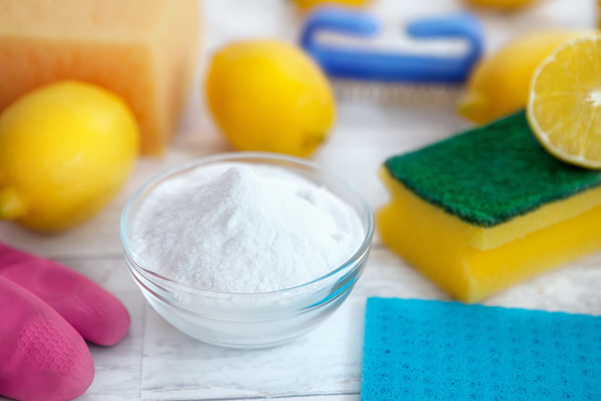 Baking soda, lemon and cleaning accessories