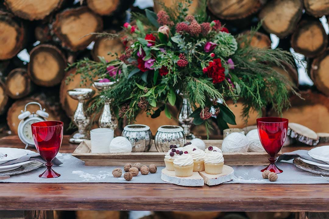 Artwork. Wedding decorations in rustic style. Festive table with beautiful flowers arrangement