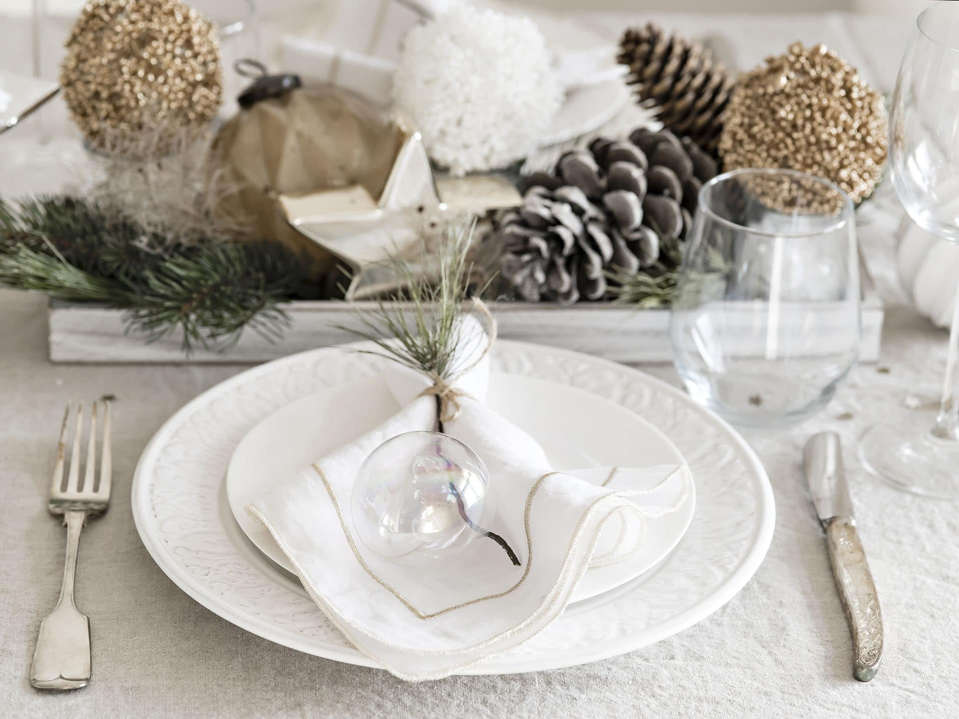 Plate and cutlery near New Year decorations.