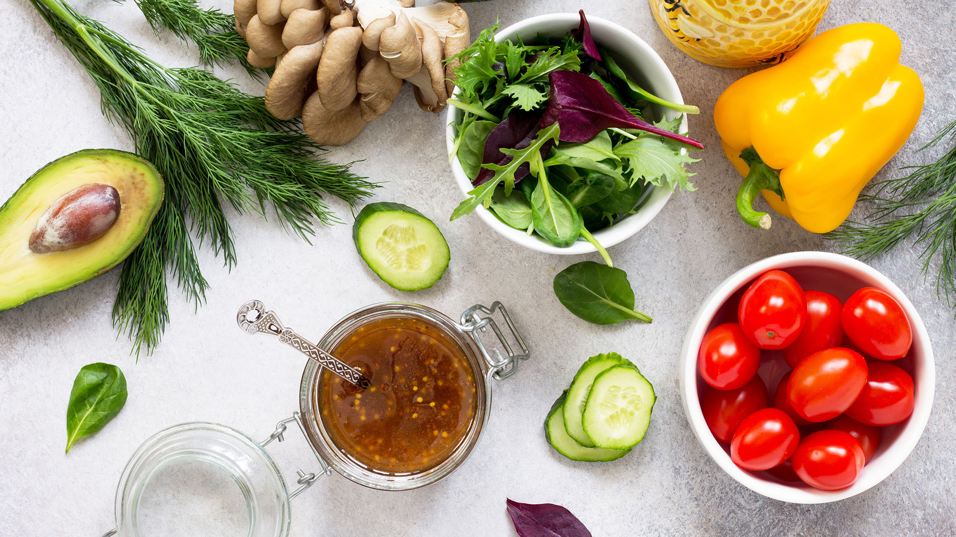 Superfoods and homemade salad dressing vinaigrette with mustard,
